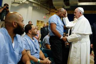 Pope Francis blesses a prisoner as he visits the Curran-Fromhold Correctional Facility in Philadelphia Sept. 27.