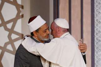 Pope Francis embraces Sheik Ahmad el-Tayeb, grand imam of al-Azhar University, at a conference on international peace in Cairo April 28. The Pope was making a two-day visit to Egypt.