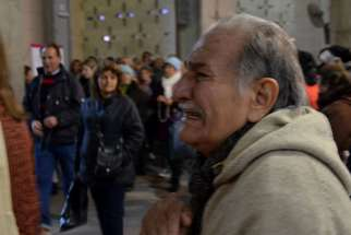 Catholic pilgrims are regularly overcome with emotion at the Shrine of Our Lady of the Rosary of San Nicolas, as this man was while visiting it on July 25, 2016, in San Nicolas de Arroyos, Argentina.