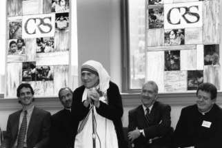 In this 1996 black-and-white file photo, Blessed Teresa of Kolkata visits Catholic Relief Services headquarters in Baltimore, Md, accompanied by Ken Hackett, second from right, U.S. ambassador to the Holy See and former president of CRS, and Sean Callahan, left, and and Bishop John H. Ricard, second from left, of Pensacola-Tallahassee, Fla.