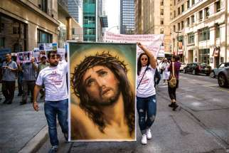 Iraqi Christians and supporters marched for religious freedom through the streets of downtown Toronto Aug. 10. Despite relative freedom, controversy over Quebec's proposed secular charter in 2013 prompted Aid to the Church in Need to designate Canada a country of concern for religious freedom.