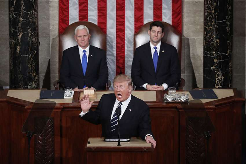 Vice President Mike Pence and U.S. House Speaker Paul Ryan, R-Wis., look on as President Donald Trump delivers his first address to a joint session of Congress Feb. 28 in Washington.