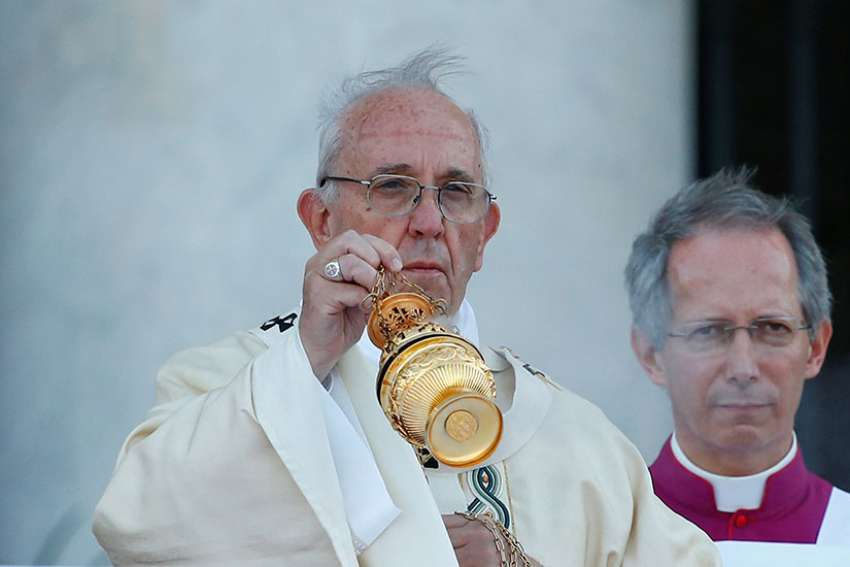 ope Francis celebrates Mass on the feast of Corpus Christi June 18 outside Rome's Basilica of St. John Lateran.