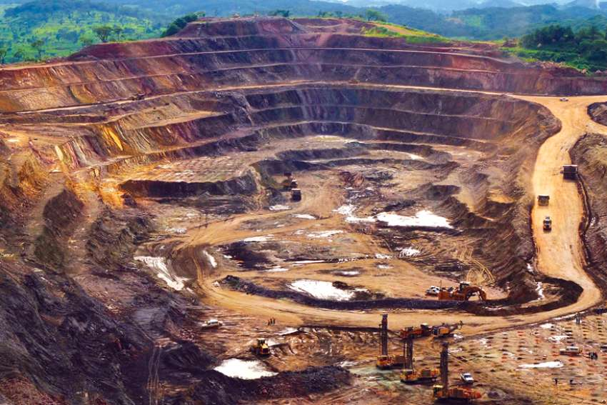 Excavators and drillers work in an open pit at a copper and cobalt mine in Likasi, Congo. There's a push on to have stock market regulators demand the truth from mining companies overseas.