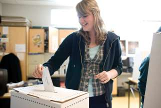 A student at Burnaby Mountain Secondary cast her vote in the Student Vote mock election. Student Vote is organized by CIVIX, a non-partisan national charity dedicated to helping youth discover and use their rights as citizens.