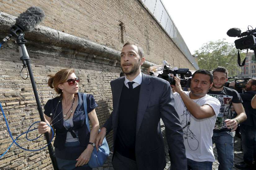 Journalist Emiliano Fittipaldi walks to his trial April 6 at the Vatican.