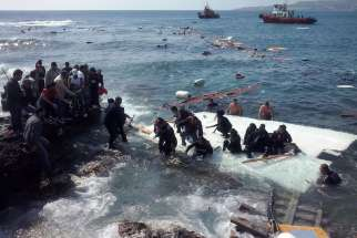 Migrants arrive at Zefyros beach near the coast of the southeastern island of Rhodes, Greece, April 20. At least three people drowned the day after Pope Francis appealed for the international community to do more to prevent such migrant deaths.