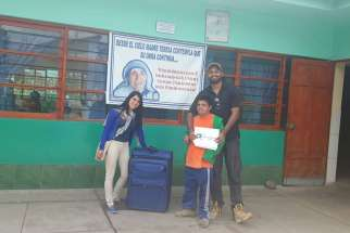 Avi D'Souza (right) recently brought a suitcase of medical supplies to a hospital run by the Missionaries of Charity Sisters in Peru.