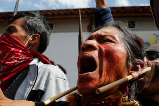 Indigenous people react during protests against Ecuadorian President Lenin Moreno's austerity measures in Quito, Ecuador, Oct.11, 2019. Ecuadorian observers at the Synod of Bishops for the Amazon at the Vatican are keeping an eye on massive protests that have claimed the lives of at least five people in their country.