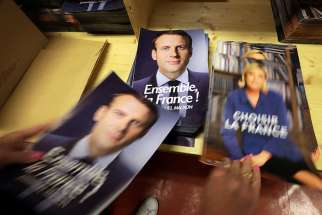 A civil servant prepares electoral documents for the May 7 second round of the French presidential election between Emmanuel Macron, left, and Marine Le Pen, in Nice, France, on May 3, 2017.
