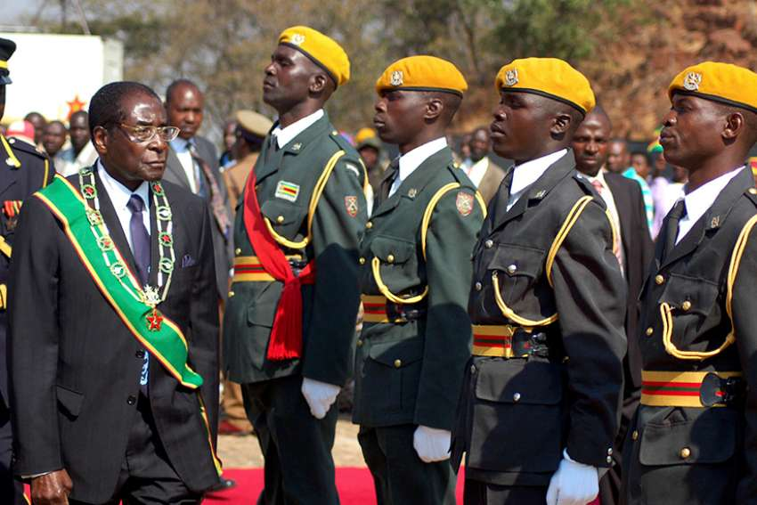 Zimbabwe President Robert Mugabe inspects soldiers in 2007 in Harare. Church leaders in Zimbabwe called for calm and for an interim government after the military seized power Nov. 15.