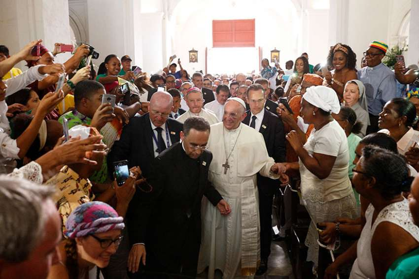 Pope Francis greets people as he arrives to visit the Shrine of St. Peter Claver in Cartagena, Colombia, Sept. 10.