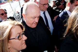 Archbishop Philip Wilson of Adelaide, Australia, arrives Aug. 14 at Newcastle Local Court. The Australian court has approved house arrest of Archbishop Wilson, who had been found guilty by an Australian court of failing to inform police about child sexual abuse allegations.