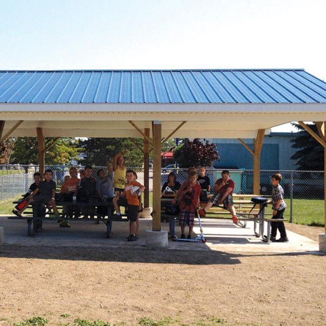 Students from St. Mary's Catholic Elementary School seek shelter from the afternoon sun under their new outdoor learning pavilion.