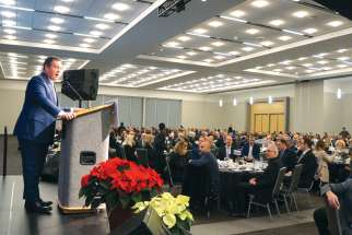 Alberta Premier Jason Kenney speaks at the revived provincial Christian prayer breakfast.