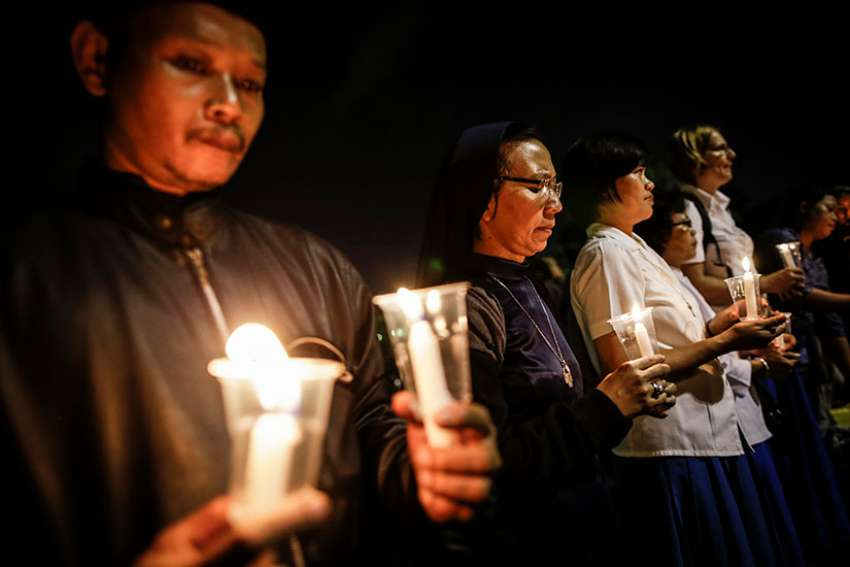 Indonesian activists hold candles during a 2016 candlelight protest against death penalty executions outside the presidential palace in Jakarta. Indonesia has rejected the possibility of abolishing the death penalty at a United Nations hearing reviewing the country's human rights situation.