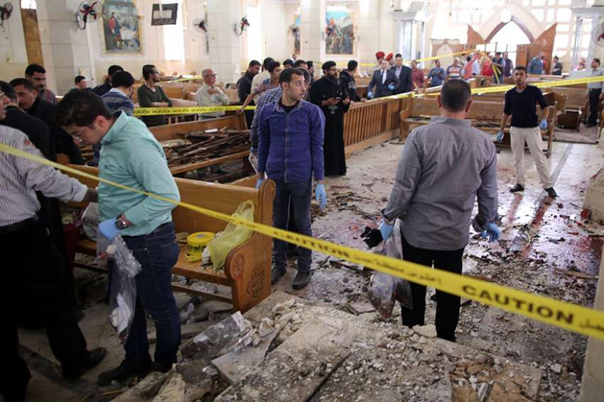 Security personnel investigate the scene of a bomb explosion April 9 inside the Orthodox Church of St. George in Tanta, Egypt April, 9.