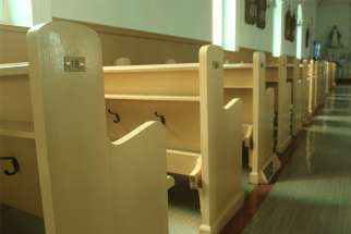 Empty pews are pictured in a file photo at St. Irenee's Catholic church in the Charlevoix region, near Quebec City. During the COVID-19 pandemic, the Quebec government is limiting churches to 50 people inside, 25 in riskier regions.