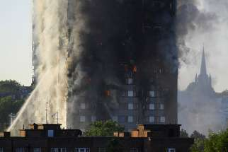 Flames and smoke billow from a London apartment building June 14. The death toll is at 79 as of June 18.