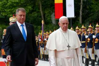 Pope Francis walks with President Klaus Iohannis of Romania during a welcoming ceremony at the entrance of the Cotroceni Palace in Bucharest, Romania, May 31, 2019. The pope is making a three-day visit to Romania.
