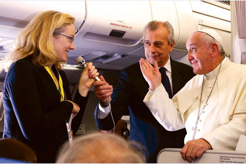 Pope Francis reacts to questions from Associated Press reporter Nicole Winfield about the September U.S. papal visit during a news conference aboard his flight from Manila, Philippines, to Rome Jan. 19.
