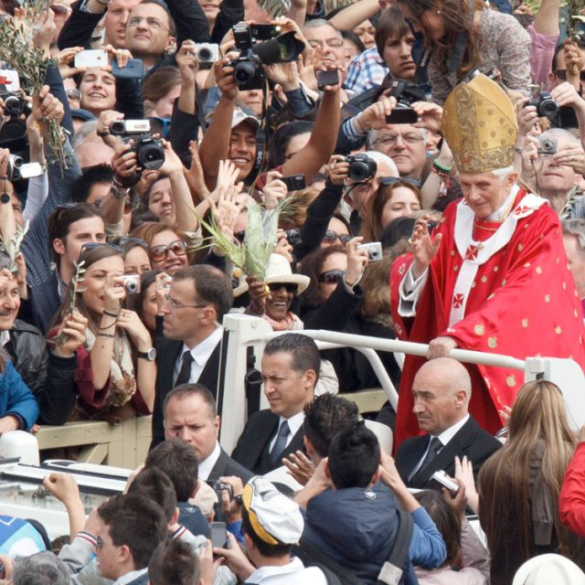 Pope Benedict XVI greets the crowd after celebrating Palm Sunday Mass in St. Peter's Square at the Vatican April 1.