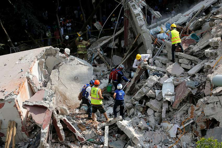 Rescue personnel remove rubble Sept. 20 at a collapsed building while searching for survivors after an earthquake hit Mexico City. The magnitude 7.1 earthquake hit Sept. 19 to the southeast of the city, killing hundreds.