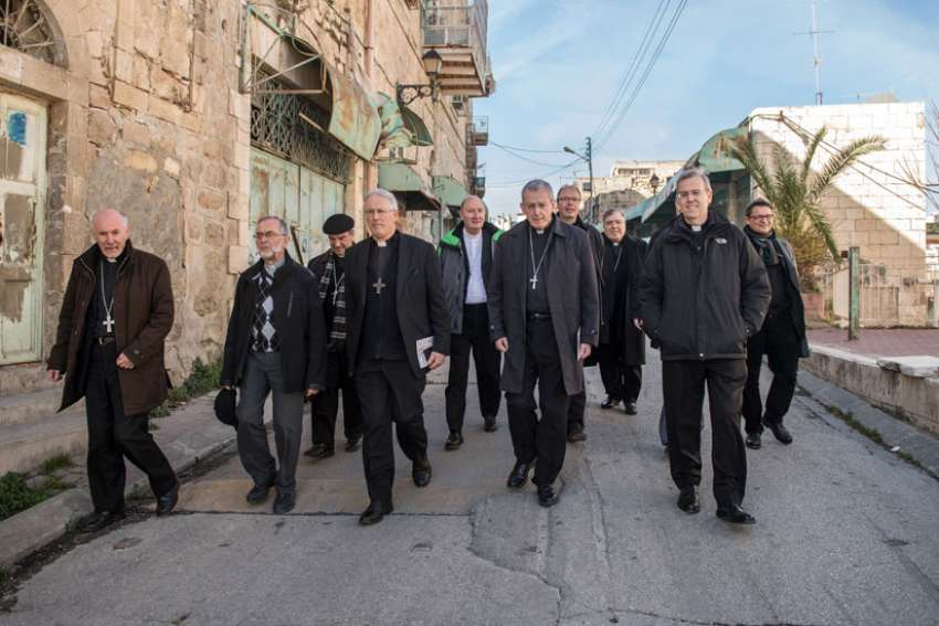 Bishops from the U.S, Canada and Europe walk through a street Jan. 16 in Hebron, West Bank.