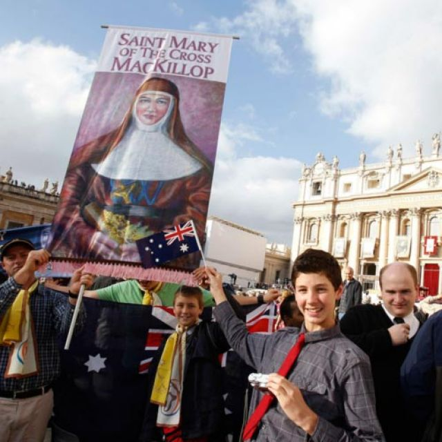 Australian pilgrims hold a banner showing new Australian St. Mary MacKillop in St. Peter's Square at the Vatican Oct. 17. Pope Benedict XVI named six new saints during the Mass of canonization.