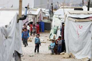 Syrian children are seen inside an informal settlement for refugees in Bar Elias, Lebanon.