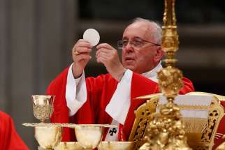 Pope Francis elevates the Eucharist during a Mass marking the feast of Sts. Peter and Paul in St. Peter's Basilica at the Vatican June 29.