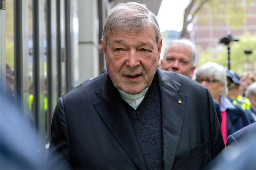 Australian Cardinal George Pell is surrounded by police as he leaves the Melbourne Magistrates Court in Australia, Oct. 6, 2017. An Australian appeals court Aug. 21, 2019, upheld the conviction of Cardinal Pell on five counts of sexually assaulting two choirboys more than two decades ago.