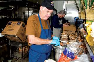 Gerald Jordan from the Knights of Columbus, Toronto Council 1388, helps out in the kitchen at Good Shepherd Ministries, where the annual Boxing Day feast will feed more than 1,200.
