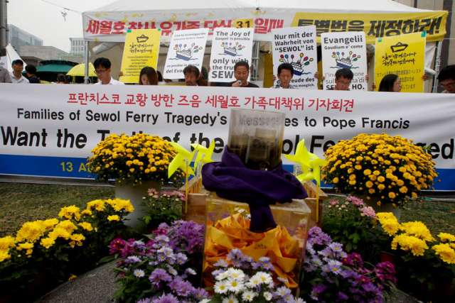 Family members of the 304 South Korean ferry victims send Pope Francis a message from Seoul, South Korea, Aug. 13. The pope is scheduled to be in the country for a five-day Asian Youth Day event.