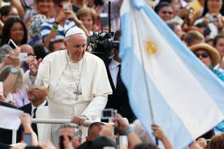 Argentina's flag is seen as Pope Francis greets the crowd during his general audience in St. Peter's Square at the Vatican Aug. 31, 2016.