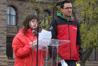 Christina Lee Fast tells the hundreds gathered at the first Toronto March for Life May 9 that her life as a woman with Down Syndrome is worth living and so are the four million lives that have been aborted in Canada since 1969. With Fast is her boyfriend, Matthew Gregory.