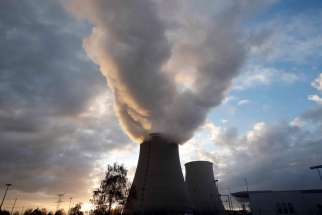 Steam rises from the cooling towers of a nuclear power station at sunset Nov. 25 in Nogent-Sur-Seine, France.