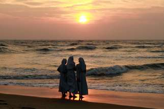 Nuns stand on a beach in Cochin, India, in this 2014 file photo.