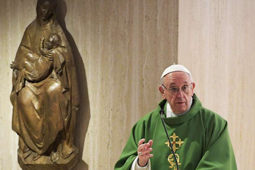Pope Francis celebrates morning Mass in the chapel of his Vatican residence at the Domus Sanctae Marthae Sept. 26.