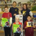 Poetic teachers Mike Maiorano and Michelle Lavey (back row) show off some of the St. John's newest equipment with the help of Jason Mannella, Grade 5, Mya Chamber, Grade 5 and Dante Salvatori, Grade 4 (left to right).