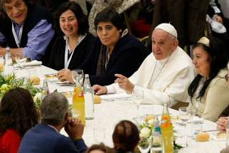 Pope Francis eats lunch with the poor in the Paul VI hall after celebrating Mass marking the first World Day of the Poor at the Vatican Nov. 19. Some 1,200 poor people joined the pope for the meal.