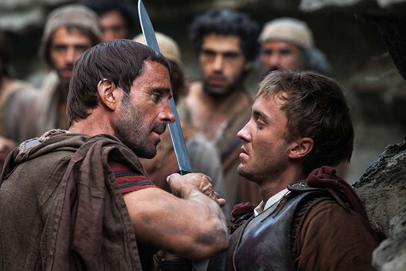 "Joseph Fiennes and Tom Felton star in a scene from the movie ""Risen."" The Catholic News Service classification is A-III -- adults. The Motion Picture Association of America rating is PG-13 -- parents strongly cautioned. Some material may be inappropriate for children under 13."