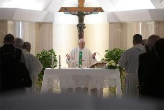 Pope Francis celebrates Mass in the chapel of his Vatican residence, the Domus Sanctae Marthae, Sept. 30, 2019.