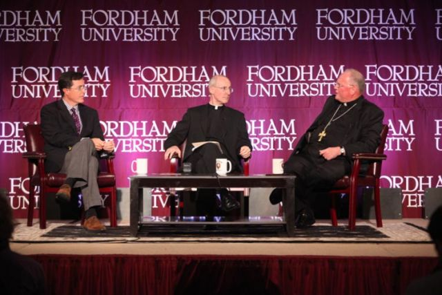 Political satirist Stephen Colbert, Jesuit Father James Martin, moderator, and New York Cardinal Timothy M. Dolan are seen during a conversation about humour, faith, joy and the spiritual life Sept. 14 at Fordham University.