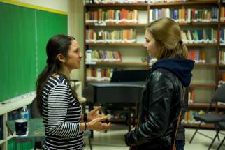 Ana Sofia Corona, left, shares tips on discernment with a student during vocations week at Seat of Wisdom College.