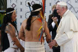 "Pope Francis greets people of the Amazon in Puerto Maldonado, Peru, Jan. 19. Pope Francis has chosen the theme, ""The Amazon: New paths for the church and for integral ecology,"" for the Synod of Bishops for the Amazon region. The synod will be held at the Vatican in October 2019."
