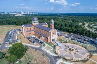 Priests gather outside Holy Name of Jesus Cathedral immediately after Mass July 26 at the dedication for the cathedral in Raleigh, N.C.