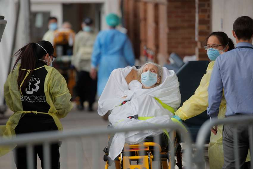 Paramedics in New York City take a patient into the Maimonides Medical Center April 7, 2020, during the coronavirus pandemic.