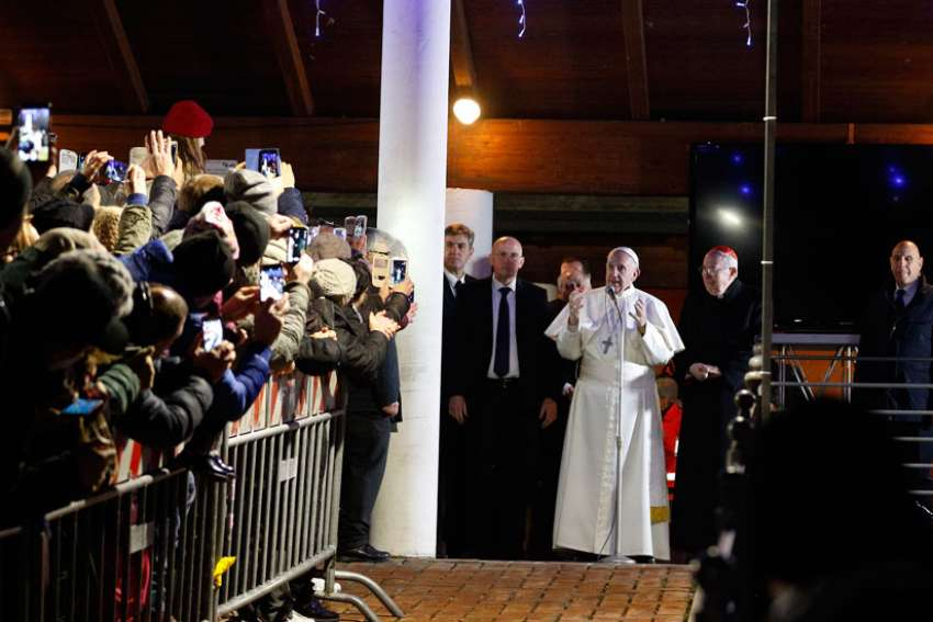 Pope Francis greets the crowd outside the church after celebrating Mass at the parish of St. Mary in the Setteville neighborhood of Rome Jan. 15.