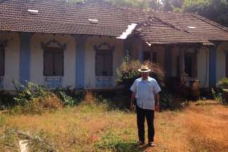 Fr. de Souza outside his maternal grandmother's now-abandoned home in Loutolim, Goa, India.